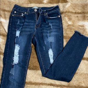 Dark distressed skinny jeans